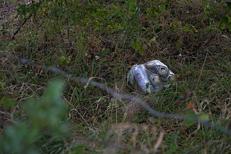 Drinks cans discarded in a plastic bag