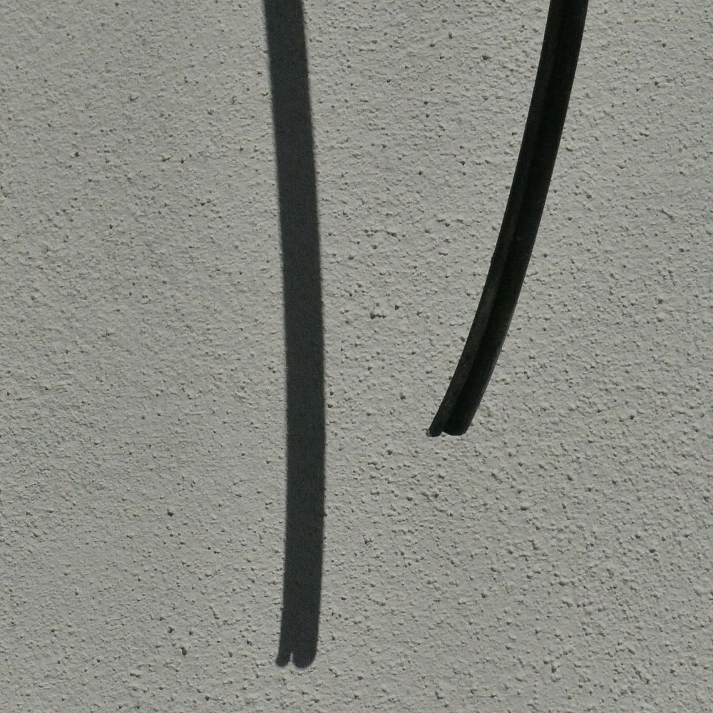 A black line and a shadow